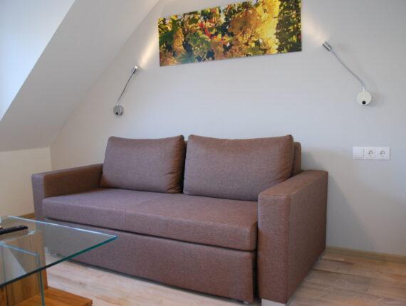 Steinfelderhof Ferienzimmer Wohnbereich mit Schlafcouch
